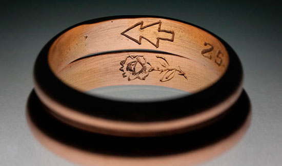 Wedding ring engraved with a rose and a pine tree
