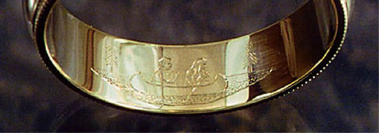 Wedding ring engraved with a canoe