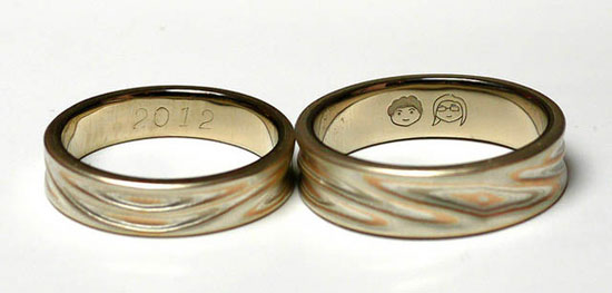 wedding ring engraved with two faces